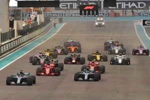 Mercedes' British driver Lewis Hamilton (left) gets away ahead of the pack at the start of the Abu Dhabi Formula One Grand Prix.