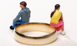 Concept image of a couple sitting on wedding rings to illustrate divorce and separation