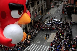 An Angry Bird balloon floats down 6th Avenue