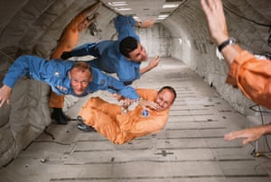 Astronauts Ted Freeman, Buzz Aldrin (centre), and Charlie Bassett experience zero gravity during a simulation flight in 1964