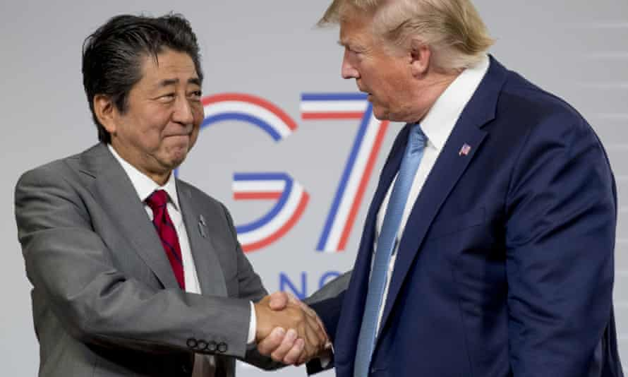 Donald Trump and Shinzo Abe shake hands following a news conference in Biarritz.