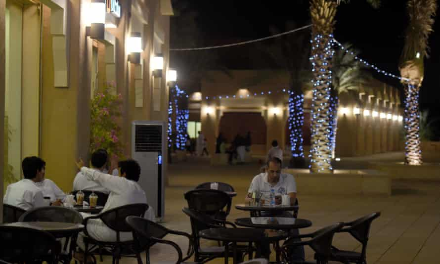 Men sitting outside a coffee shop in the Atturaif district on the outskirts of Riyadh, which is part of a major development project shepherded by King Salman.