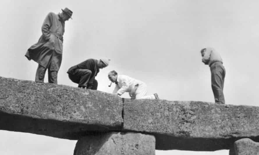 Photographs from the 1958 restoration project show people smoking pipes and wearing trilbies as they stand on top of stones.