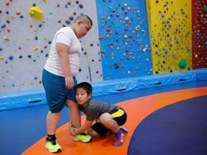 Kumagai wrestles with a boy the same age as him