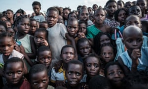 Children wait to receive food at an evacuation centre in Dondo, about 35km north of Beira, Mozambique.
