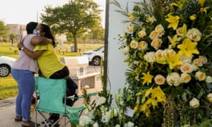 Mourners hug each other at Houston Memorial Gardens cemetery, where George Floyd was buried.