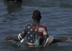 A migrant wades across the Rio Grande from Ciudad Acuña, Mexico, to Del Rio, Texas