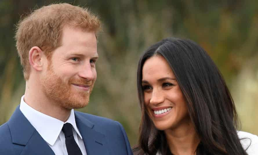 Prince Harry poses with Meghan Markle at Kensington Palace.