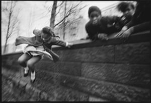 Girl jumping over a wall, Central Park, New York, 1967