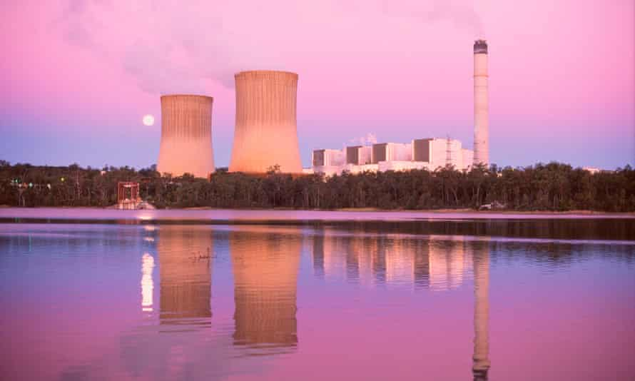 Water vapour and unseen oxides of carbon rise from a coal-fired power station in Queensland, Australia.