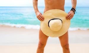 Naked man covering himself with straw hat