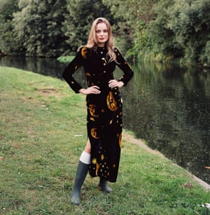 A model standing by a lake wearing the Celestial Moon velvet dress by the hot London label Farleigh.io