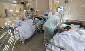 Medical workers care for people at City clinical hospital No 7 in Ivanovo, Russia.