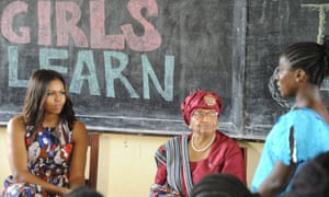 Michelle Obama has told girls in Liberia to fight to stay in school, as she visited the west African country where the vast majority drops out due to financial pressures.