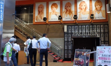 Local officials check a nightclub in Kabukicho on 21 July.