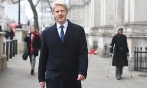Jo Johnson walking through Whitehall