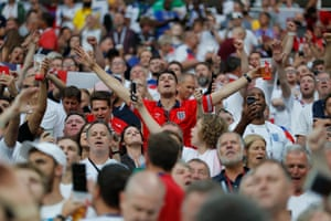 The England fans in the Luzhniki Stadium are enjoying themselves.
