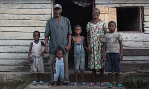 Emmanuel Ngalle and his family on their porch in Cameroon
