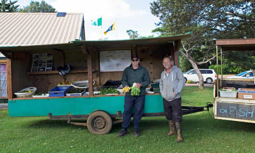 Phill Evans (left) and his brother Haydn (right) at their farmers' market stall. Haydn is a member of the Norfolk Island legislative assembly and works full-time job at his family farm