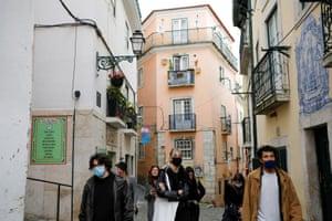 Tourists walk in the Alfama neighbourhood amid the coronavirus pandemic, in Lisbon, Portugal, on 11 March, 2021.