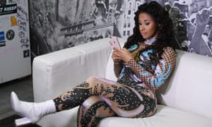Cardi B on her phone