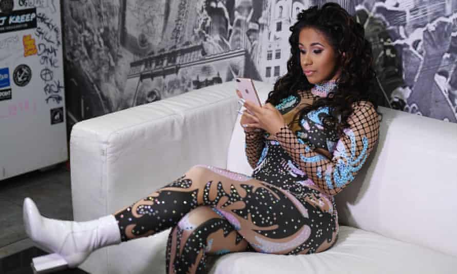 Cardi B on her phone