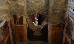 Visitors walk inside the Criptoporticus Domus