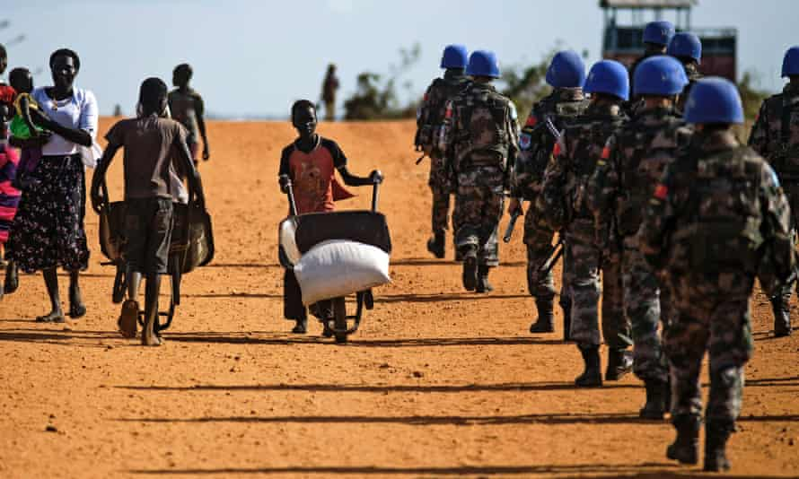 Peacekeeper troops from Chinain Juba, South Sudan. A report says they and forces from other countries 'underperformed' during violence in the city in July.