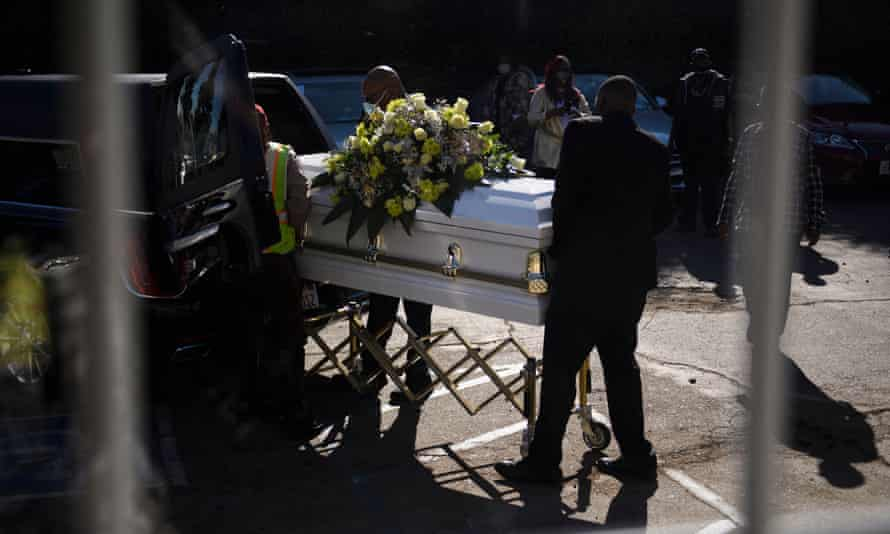 A casket is loaded into a hearse at the Boyd Funeral Home, as burials at cemeteries are delayed due to the surge of Covid-19 deaths, in Los Angeles, California.