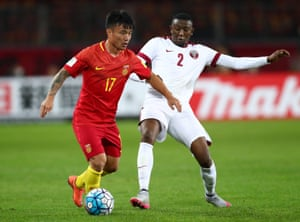 China's Cao Yunding  holds off Qatar's Mohamed Musa