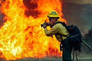 The San Diego County Sheriff's department issued a voluntary evacuation order on Sunday afternoon as Valley fire raged unchecked on the eastern edge of the metropolitan area of more than 3 million people