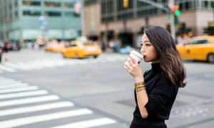 USA, New York City, Manhattan, young woman drinking coffee to go on the street<br>Fashionable young asian woman commuting in the streets of Manhattan (travel, journey, commute,tourism, walk,city life)