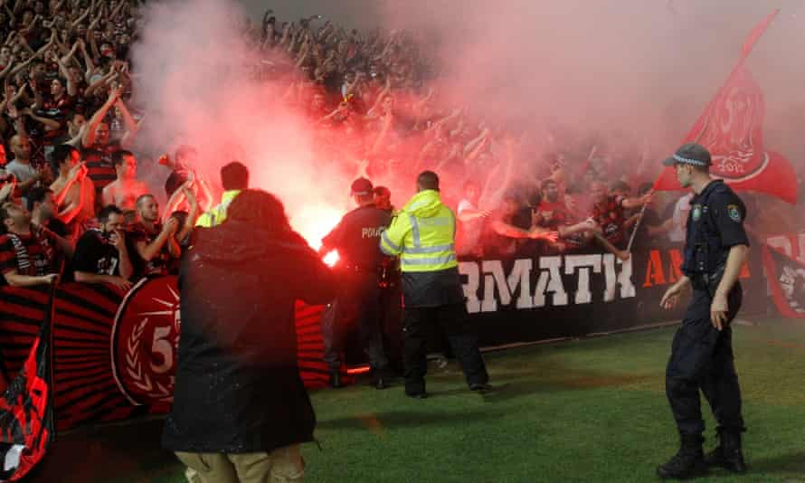 Wanderers fans lit 3 flares taunting Police and Security during the AFC Champions League qualifying match between the Western Sydney Wanderers and Ulsan Hyundai from Korea at Parramatta Stadium, Wednesday, Feb. 26, 2014.