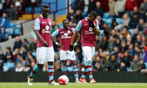 The Aston Villa players look forlorn after Steve Cook put Bournemouth ahead in first-half stoppage time.