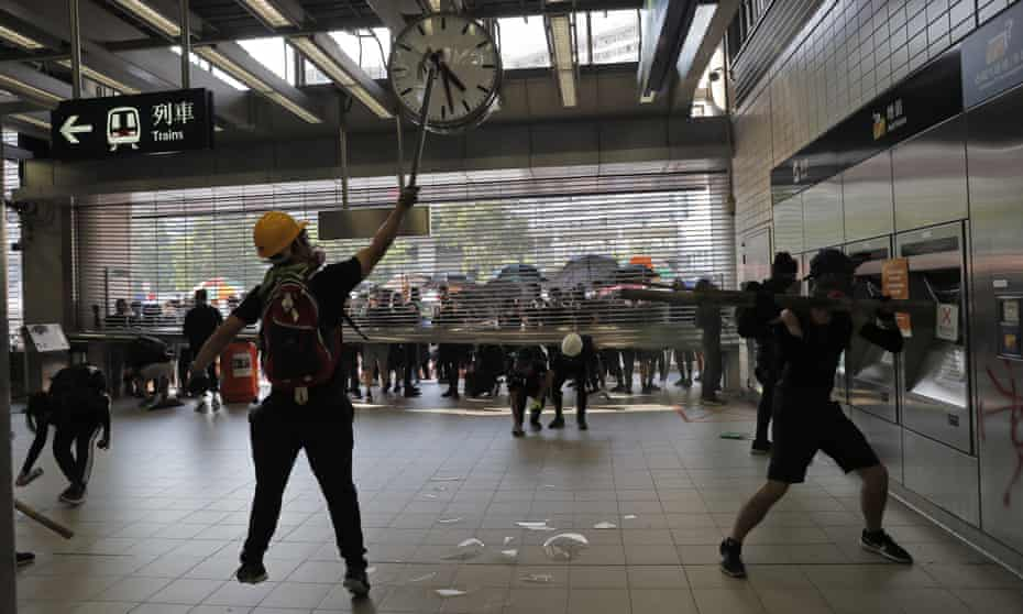 Anti-government protesters vandalise an MTR public transport station in Hong Kong.