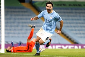 Ilkay Gundogan celebrates after doubling Manchester City's lead.