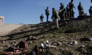 Bones, hair and traditional Yazidi garb at mass grave
