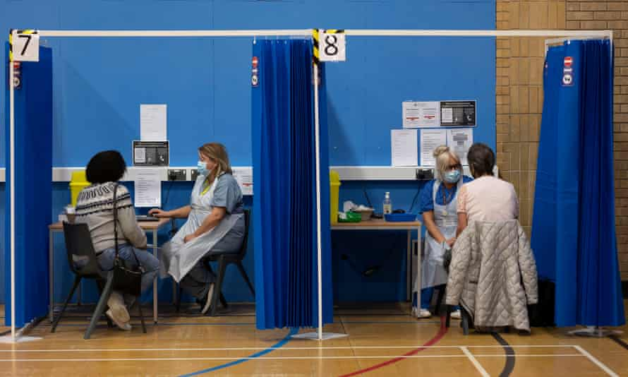 Health workers and patients at a vaccination centre in a leisure centre in Barry, Wales