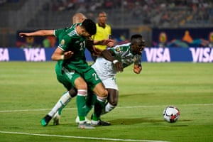 Algeria's Ramy Bensebaini (No 21) and Adlene Guedioura combine to thwart Senegal's forward Sadio Mane.
