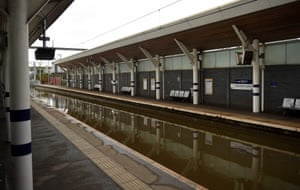 Water covers the rail tracks at Rotherham Central train station