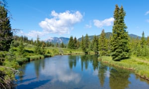 Widescreen view of mountains, lake and forest at Willmore wilderness park, Alberta Canada.