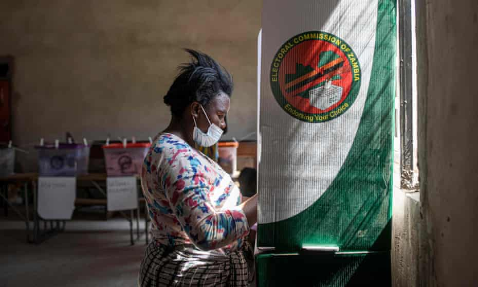 A woman fills her ballot at a polling station in Lusaka.