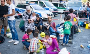 People who have been detained by police gather in a holding area at Munich main railway station.