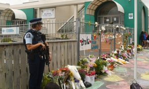Armed police guard Wellington's Kilbirnie mosque as wellwishers bring tributes.