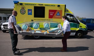 Members of the UK armed forces work with NHS medical staff and Air Ambulance Service crews at Thruxton Aerodrome.
