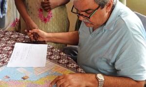 Dr Vatwani with a patient.