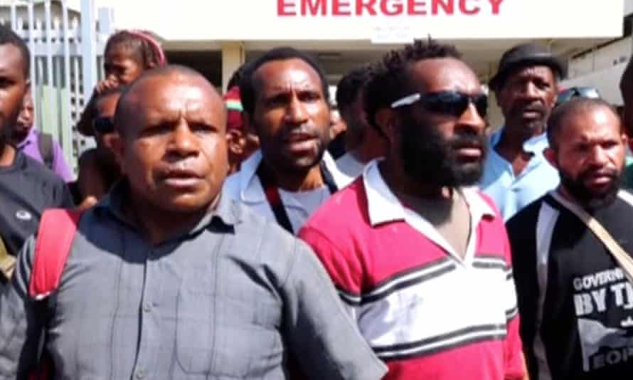 Protesters gather outside a hospital in Port Moresby