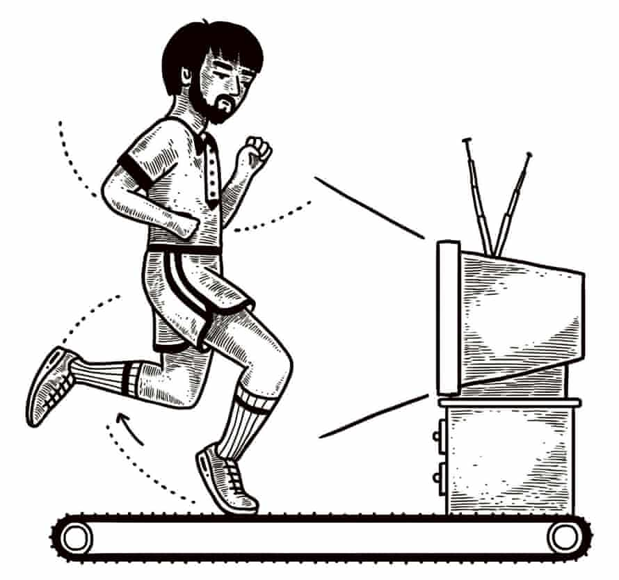 a man watching TV while running on a treadmill