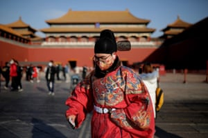 A man wearing Chinese traditional clothes and protective face mask on the way to visit the Forbidden City during the 2021 New Year holidays, in Beijing, China, 01 January 2021.