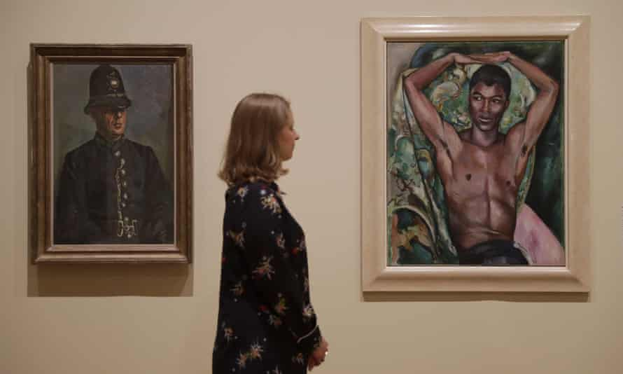 On the left, Duncan Grant's portrait of PC Harry Daley and, at left, Edward Wolfe's Portrait of Pat Nelson.